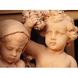 Mural escultura niños