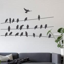 Vinilo pájaros sobre cable