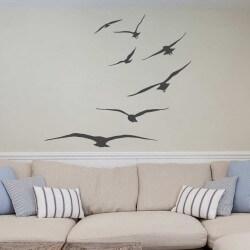 Vinilo pájaros volando en bando